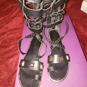 72df57713b9f Fergie Shoes - Black and Gold Gladiator Flat Sandals